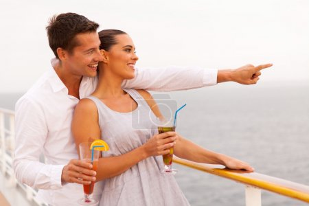 Couple having cocktail on cruise ship