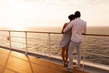 Couple standing on ship deck