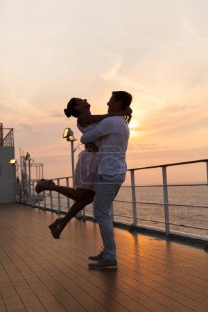 Couple enjoying romantic sunset on cruise