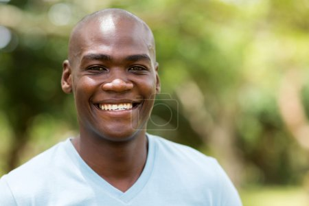 Photo for Close up portrait of young african american man smiling  outdoors - Royalty Free Image