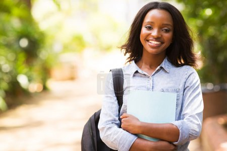 Photo for Portrait of african college student holding a book - Royalty Free Image