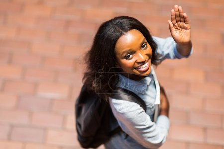Photo pour Overhead view of african american student waving goodbye - image libre de droit