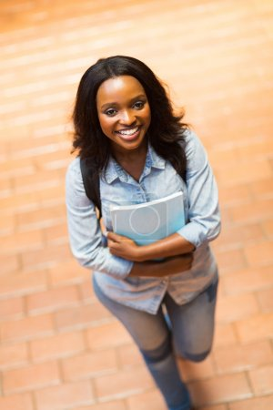 Photo for Cheerful young african american college girl walking on campus - Royalty Free Image