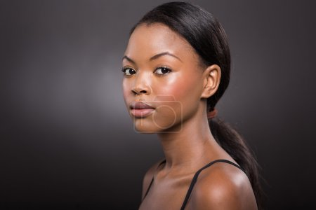 Photo for Gorgeous young african american woman with natural makeup on black background - Royalty Free Image