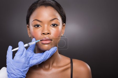 Woman receiving cosmetic injection
