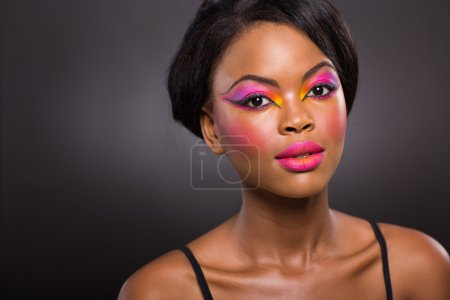 Photo for Portrait of afro american woman with colorful makeup - Royalty Free Image