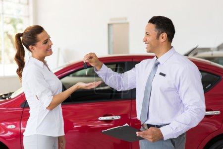 Woman receiving new car key