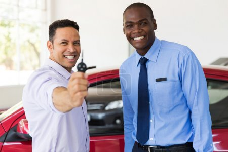 Man showing new car key