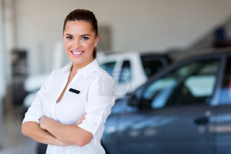 female car dealer with arms crossed