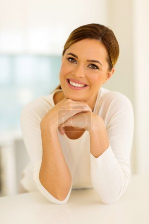 Photo for Smiling young woman in modern kitchen - Royalty Free Image