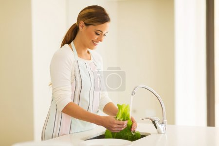 Housewife washing vegetables