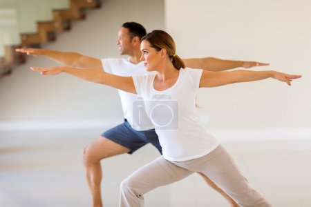 couple exercising indoors