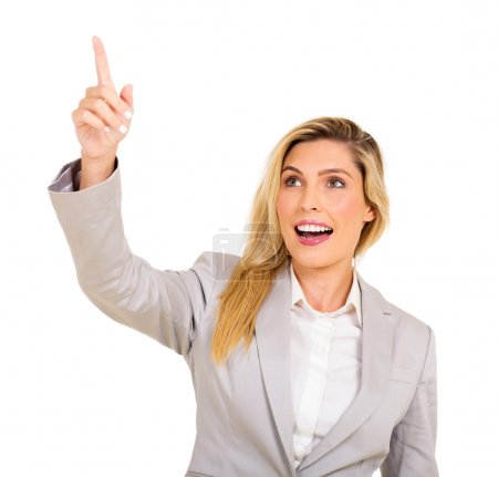 Photo for Cheerful businesswoman pointing up on white background - Royalty Free Image