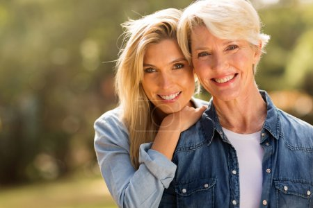 Mature mother and  daughter  smiling