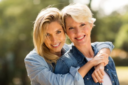 Photo for Close up portrait of mother and daughter hugging - Royalty Free Image