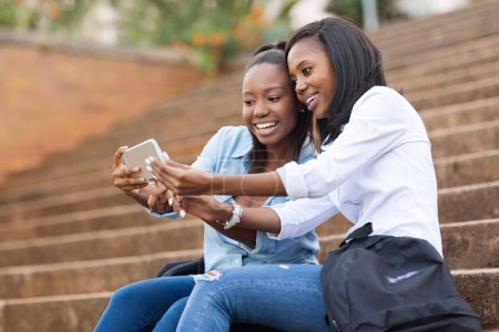 Students using cell phone on campus