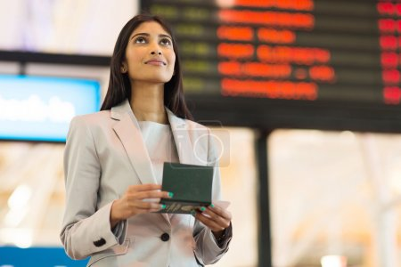 Woman checking flight information