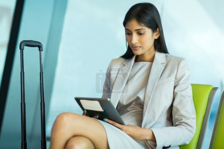 Businesswoman reading her emails