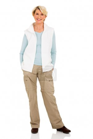 Photo for Portrait of senior woman in casual clothes isolated on white background, hands in pockets - Royalty Free Image