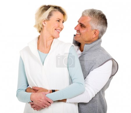 Photo for Cheerful senior couple looking at each other on white background - Royalty Free Image