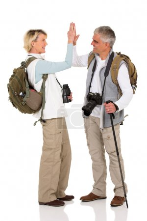 Hiking couple giving high five