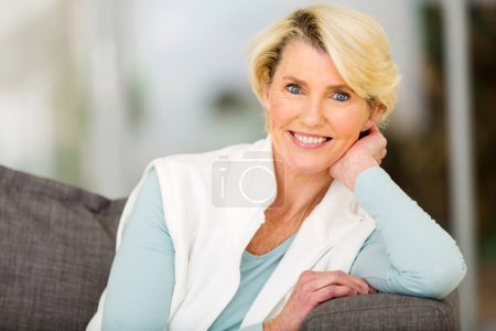 Photo for Portrait of beautiful senior woman daydreaming at home - Royalty Free Image