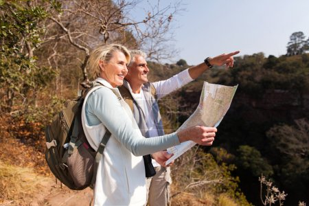 senior hikers with map