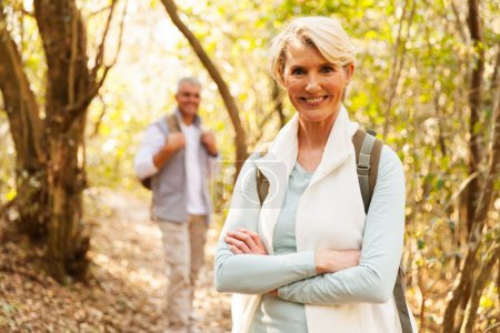 Photo for Beautiful senior woman hiking in the mountain with husband - Royalty Free Image