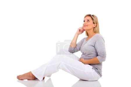 pregnant woman on floor