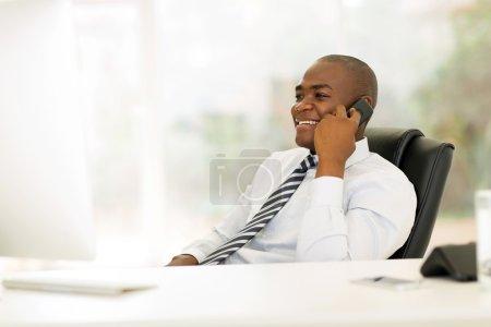 business man talking on landline phone