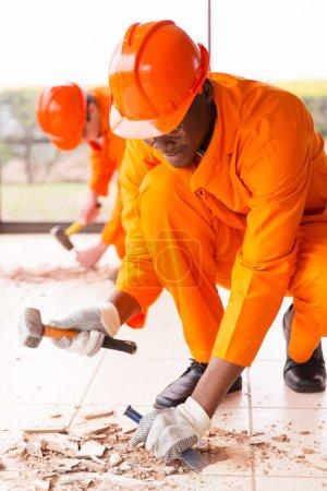 builders removing old floor tiles