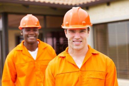 Happy young builders