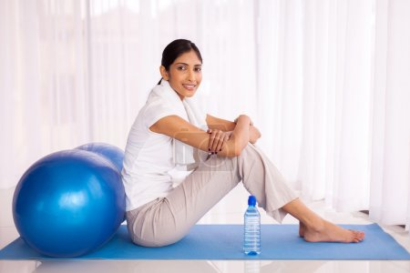 woman relaxing after exercise at home