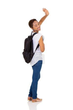 student waving goodbye