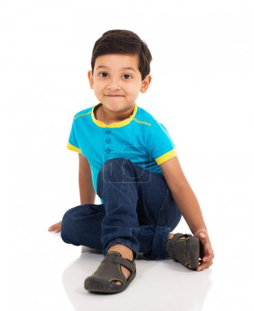 indian boy sitting on floor