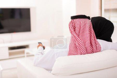 Arabian couple watching tv