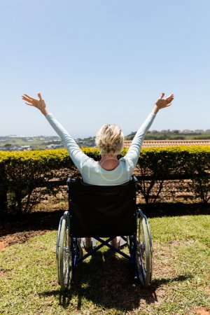disabled woman sitting outdoors