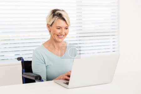 handicapped woman using laptop