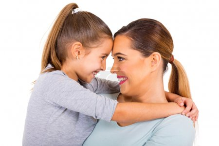 Photo for Close up portrait of embracing mother and daughter on white background - Royalty Free Image