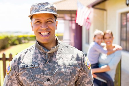 Cheerful american military soldier standing in fro...