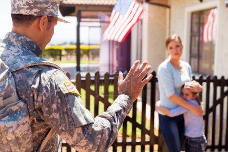 military father waving goodbye