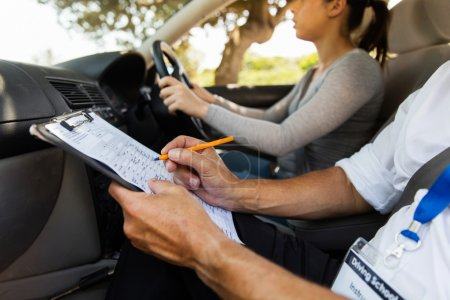 Photo for Portrait of senior driving instructor and student driver during lesson - Royalty Free Image