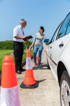 Photo for Young student driver and instructor doing pre test inspection - Royalty Free Image