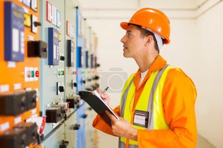 electrical engineer taking machine readings