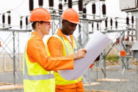 electricians holding blueprint