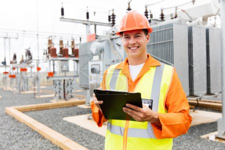 Photo for Handsome electrical engineer holding clipboard - Royalty Free Image