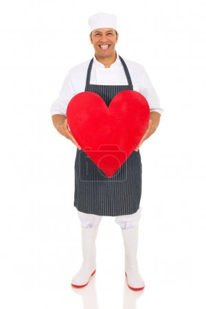 butcher holding red heart
