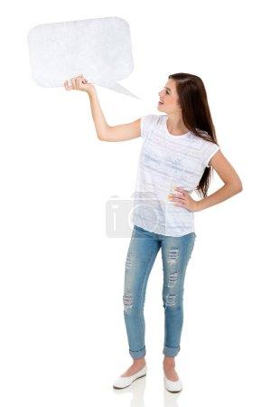Girl holding speech bubble