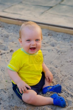Toddler Boy playing in a sandbox