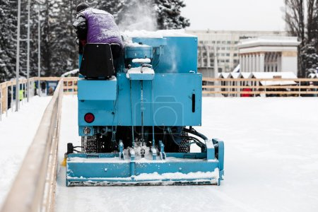 Special machine cleaning ice at ice skate rink.